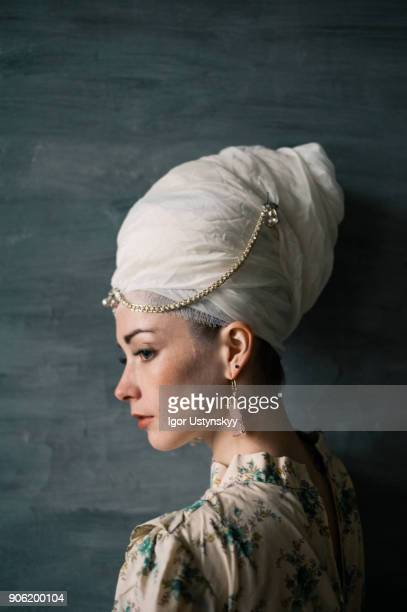 Beauty young woman with hairs wrapped in turban