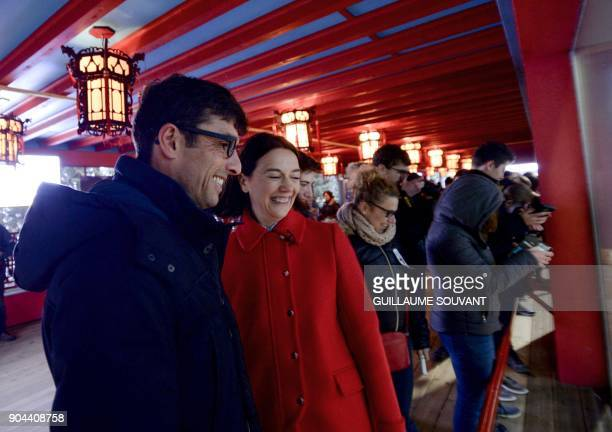 Beauval Zoo director Rodolphe Delord and his sister the zoo's head of communication Delphine Delord look on as Panda cub Yuan Meng and its mother...