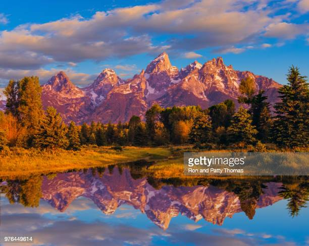 beaver pond glows in dusk light at grand teton national park - jackson hole stock pictures, royalty-free photos & images