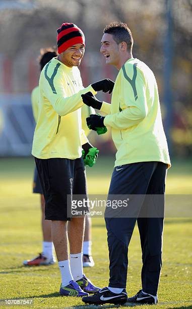 Bebe and Federico Macheda of Manchester United share a joke during a training session ahead of their UEFA Champions League group C match against...