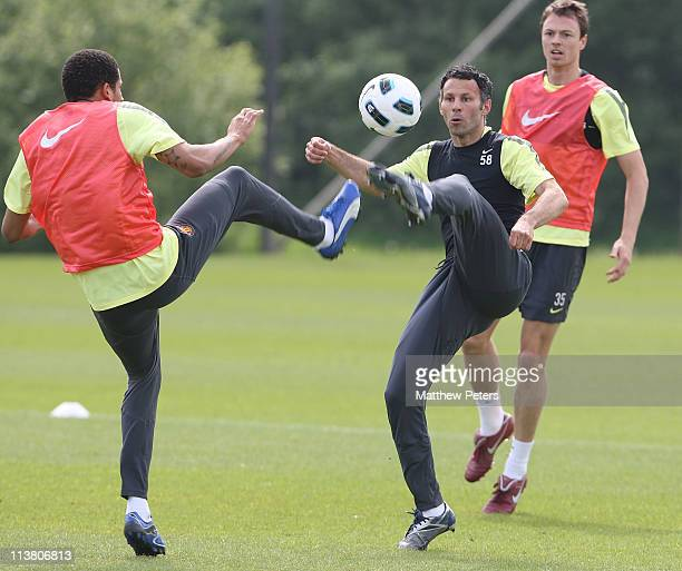 Bebe and Ryan Giggs of Manchester United in action during a first team training session at Carrington Training Ground on May 6 2011 in Manchester...