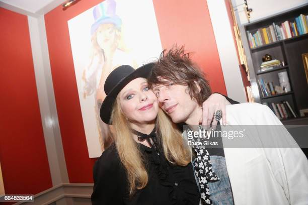 Bebe Buell and her husband Jimmy Walls pose as Buell visits the HGU New York's 1905 Lounge at the HGU New York Hotel on April 4, 2017 in New York...