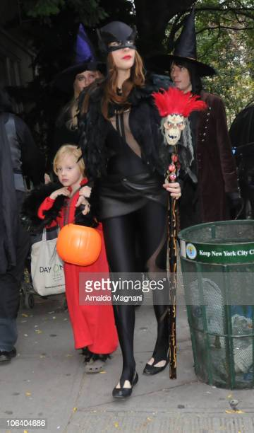 Bebe Buell Liv Tyler and Jim Wallerstein walk in the city on October 31 2010 in New York City