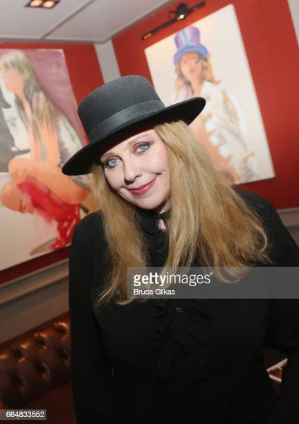 Bebe Buell poses in front of a portrait of herself as she visits the HGU New York's 1905 Lounge at the HGU New York Hotel on April 4, 2017 in New...