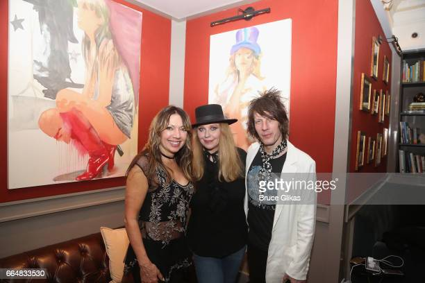 Bebe Buell poses with her band drummer Mindy Wright and musical director/guitarist Jimmy Walls as she visits the HGU New York's 1905 Lounge at the...