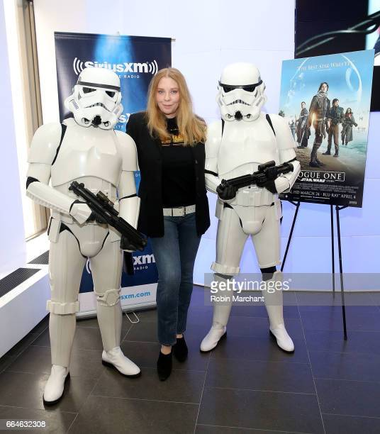 Bebe Buell poses with Stormtroopers for Blu-Ray release of Rouge One at SiriusXM Studios on April 4, 2017 in New York City.