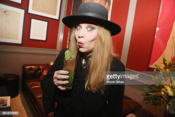 """Bebe Buell poses with the """"Bebe Buell cocktail"""" as she visits the HGU New York's 1905 Lounge at the HGU New York Hotel on April 4, 2017 in New York..."""