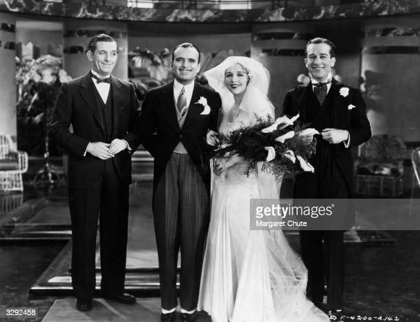 Bebe Daniels marries Douglas Fairbanks in the sight of Edward Everett Horton and Jack Mulhall in a scene from the film 'Reaching For The Moon'...