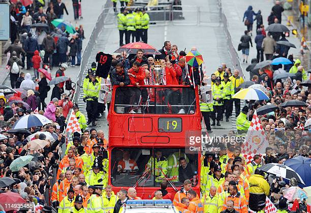 Bebe Edwin Van Der Sar and Dimitar Berbatov of Manchester United celebrate with the trophy during the Manchester United Premier League Winners Parade...