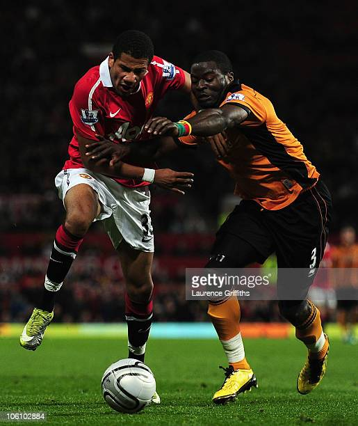 Bebe of Manchester United beats George Elokobi of Wolves on his way to scoring the opening goal during the Carling Cup fourth round match between...