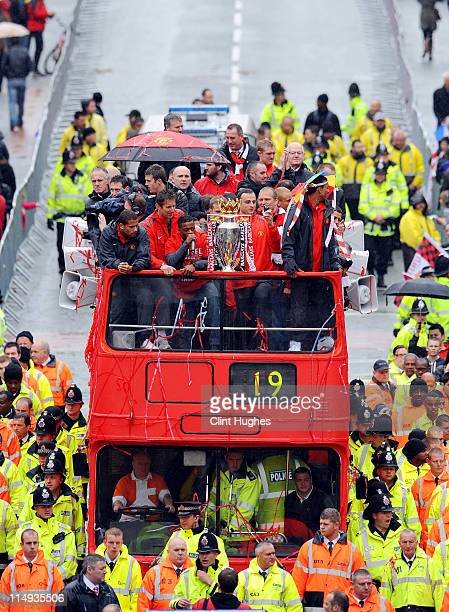 Bebe Patrice Evra and Dimitar Berbatov of Manchester United celebrate with the trophy during the Manchester United Premier League Winners Parade on...