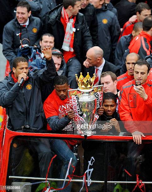Bebe Patrice Evra Antonio Valencia and Dimitar Berbatov of Manchester United celebrate with the trophy during the Manchester United Premier League...