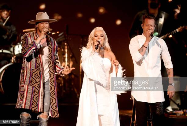 Bebe Rexha and Florida Georgia Line's Brian Kelley and Tyler Hubbard perform onstage during the 2017 American Music Awards at Microsoft Theater on...