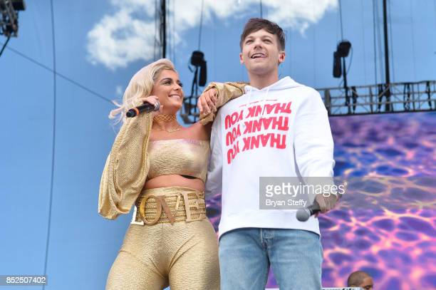 Bebe Rexha and Louis Tomlinson perform onstage during the Daytime Village Presented by Capital One at the 2017 HeartRadio Music Festival at the Las...
