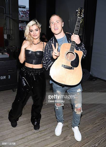 Bebe Rexha and Mike Posner pose backstage during 1035 KTU's KTUphoria 2016 presented by Aruba at Nikon at Jones Beach Theater on June 4 2016 in...