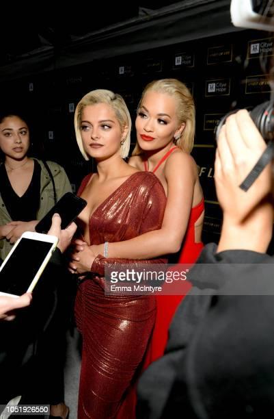 Bebe Rexha and Rita Ora attend the City of Hope Spirit of Life Gala 2018 at Barker Hangar on October 11 2018 in Santa Monica California
