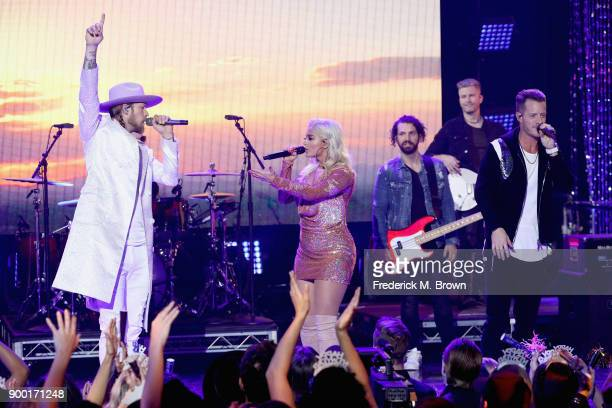 Bebe Rexha Brian Kelley and Tyler Hubbard of Florida Georgia Line perform onstage during Dick Clark's New Year's Rockin' Eve with Ryan Seacrest 2018...