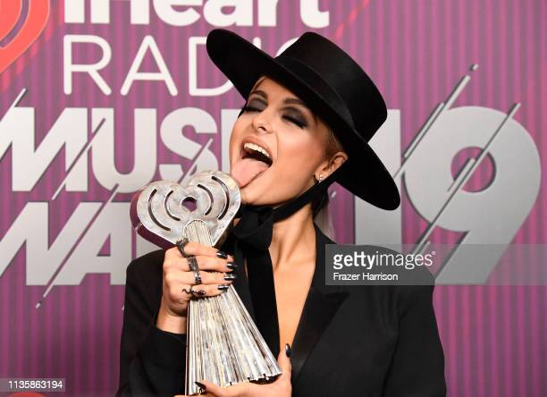 Bebe Rexha cowinner of Country Song of the Year for Meant to Be poses in the press room during the 2019 iHeartRadio Music Awards which broadcasted...