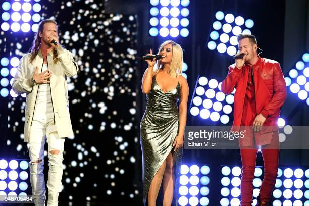 Bebe Rexha performs with Brian Kelley and Tyler Hubbard of musical group Florida Georgia Line onstage during the 53rd Academy of Country Music Awards...