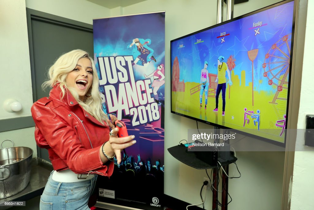 Bebe Rexha warms up with Just Dance 2018 before announcing the game via live performance onstage during the Ubisoft E3 2017 conference at Orpheum Theatre on June 12, 2017 in Los Angeles, California.