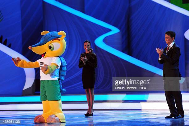 Bebeto and Marta applaud the official mascot Fuleco during the Final Draw for the 2014 FIFA World Cup Brazil at Costa do Sauipe Resort on December 6...