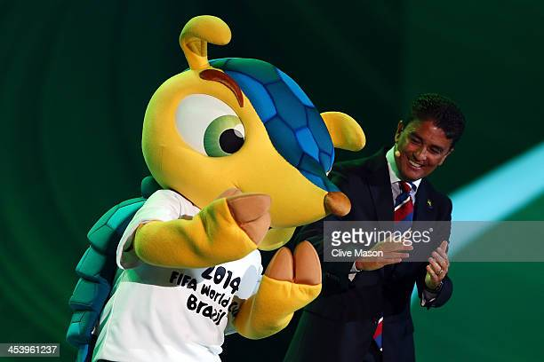 Bebeto performs his famous goal celebration with the official mascot Fuleco during the Final Draw for the 2014 FIFA World Cup Brazil at Costa do...