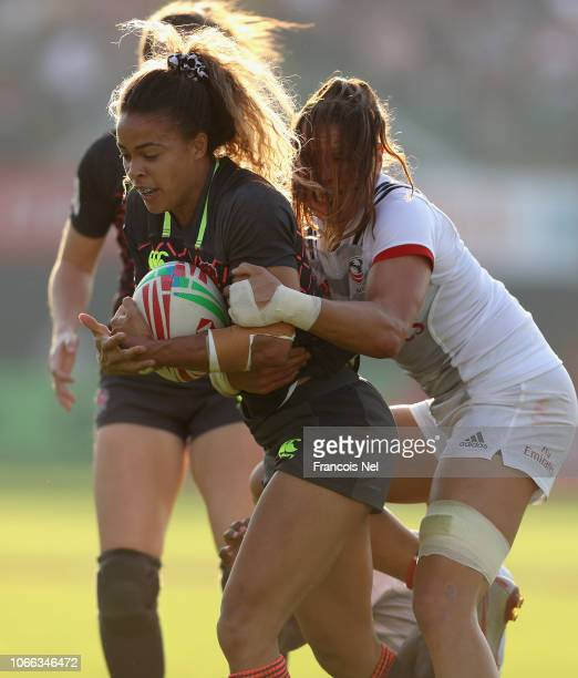 Beborah Fleming of England is tackled by Alev Kelter of USA on day one of the Emirates Dubai Rugby Sevens HSBC World Rugby Sevens Series at The...