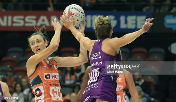 Bec Bulley of the Giants competes for the ball with Gabi Simpson of the Firebirds during the round four Super Netball match between the Giants and...