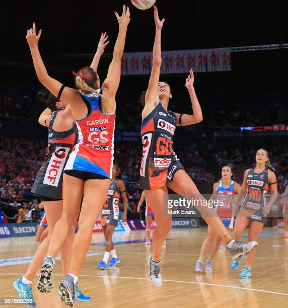 Bec Bulley of the Giants contests the ball with Sophie Garbin of the Swifts during the round three Super Netball match between the NSW Swifts and...