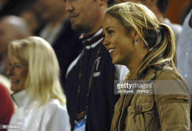 Bec Cartwright from Home and Away watches Lleyton Hewitt defeat Juan Ignacio Chela as his mum also watches the action