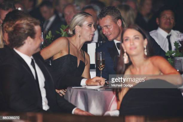 Bec Cartwright speaks to husband and former tennis players Lleyton Hewitt speak on stage at the 2017 Newcombe Medal at Crown Palladium on November 27...