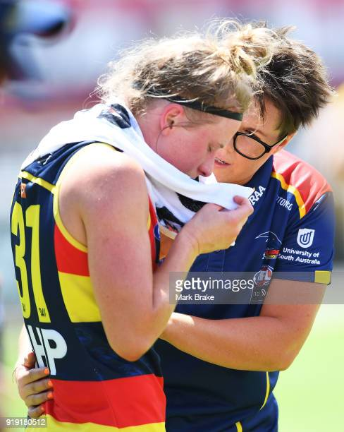 Bec Goddard Adelaide Crows coach chats to Dayna Cox of the Adelaide Crows during the round three AFLW match between the Adelaide Crows and the...