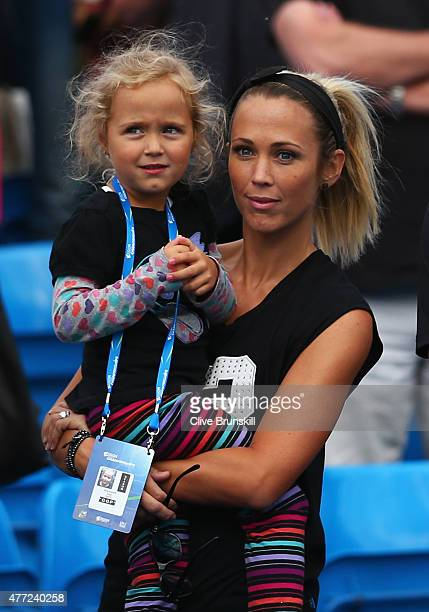 Bec Hewitt and daughter Ava watch Lleyton Hewitt of Australia in his men's singles first round match against Kevin Anderson of South Africa during...