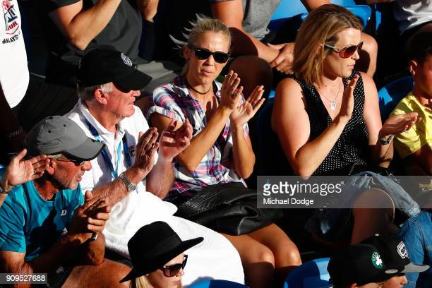 Bec Hewitt watches her husbane Lleyton Hewitt of Australia and Sam Groth of Australia compete in their quarterfinal match against Juan Sebastian...
