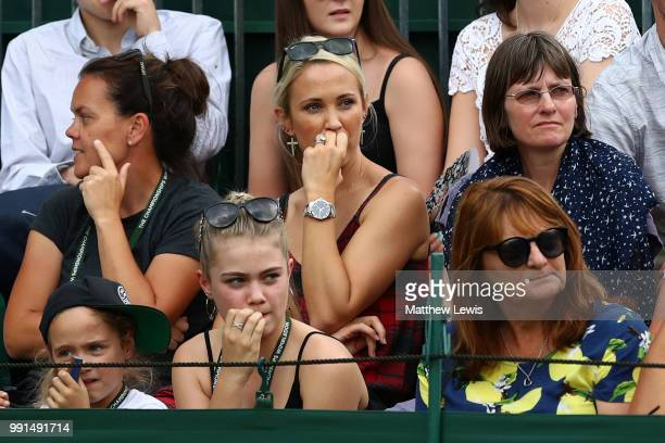 Bec Hewitt wife of Lleyton Hewitt of Australia watches the action during her husband's Men's Doubles first round match against Raven Klaasen of South...