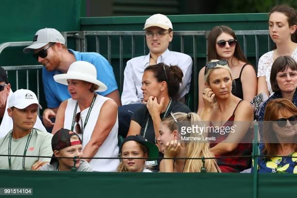Bec Hewitt wife of Lleyton Hewitt of Australia watches the action behind her children Ava Cruz and Mia Hewitt during her husband's Men's Doubles...