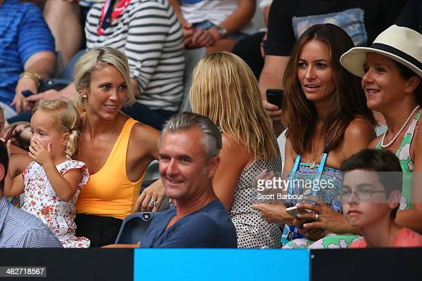 Bec Hewitt wife of Lleyton Hewitt of Australia with Lara Feltham wife of Pat Rafter of Australia watch the first round men's doubles match between...