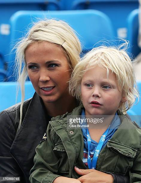 Bec Hewitt wife of Lleyton Hewitt of Australia with their son Cruz during the Men's Singles second round match against Grigor Dimitrov of Bulgaria on...