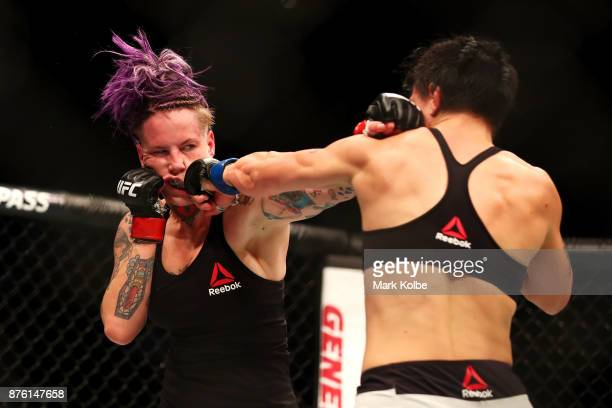 Bec Rawlings of Australia is punched by JessicaRose Clark of Australia in their women's flyweightbout during the UFC Fight Night at Qudos Bank Arena...