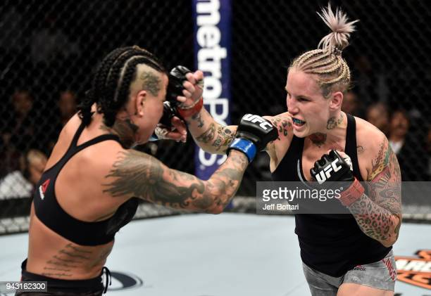 Bec Rawlings of Australia punches Ashlee EvansSmith in their women's flyweight bout during the UFC 223 event inside Barclays Center on April 7 2018...