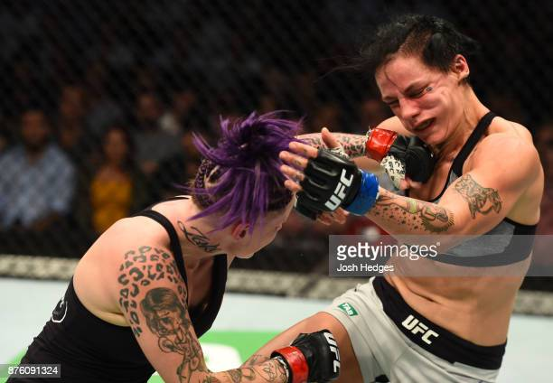 Bec Rawlings of Australia punches JessicaRose Clark in their women's flyweight bout during the UFC Fight Night event inside the Qudos Bank Arena on...