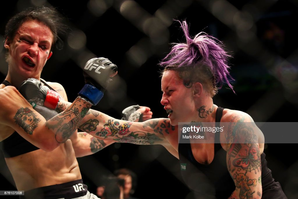 Bec Rawlings (R) of Australia punches Jessica-Rose Clark of Australia in their women's flyweightbout during the UFC Fight Night at Qudos Bank Arena on November 19, 2017 in Sydney, Australia.
