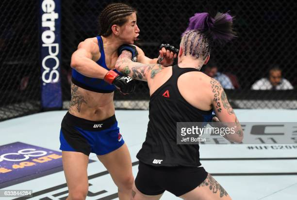 Bec Rawlings of Australia punches Tecia Torres in their women's strawweight bout during the UFC Fight Night event at the Toyota Center on February 4...