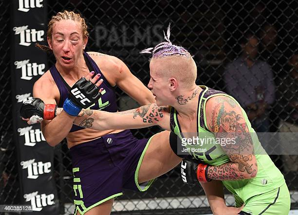 Bec Rawlings punches Heather Jo Clark in their strawweight fight during The Ultimate Fighter Finale event inside the Pearl concert theater at the...