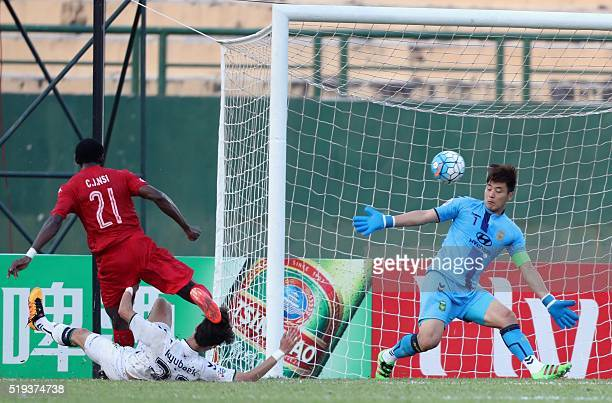Becamex Binh Duong's Christian Jose Nsi Amougou scores a goal past Jeonbuk Hyundai Motors' goalkeeper Kwoun Suntae during an AFC C1 Group E match at...