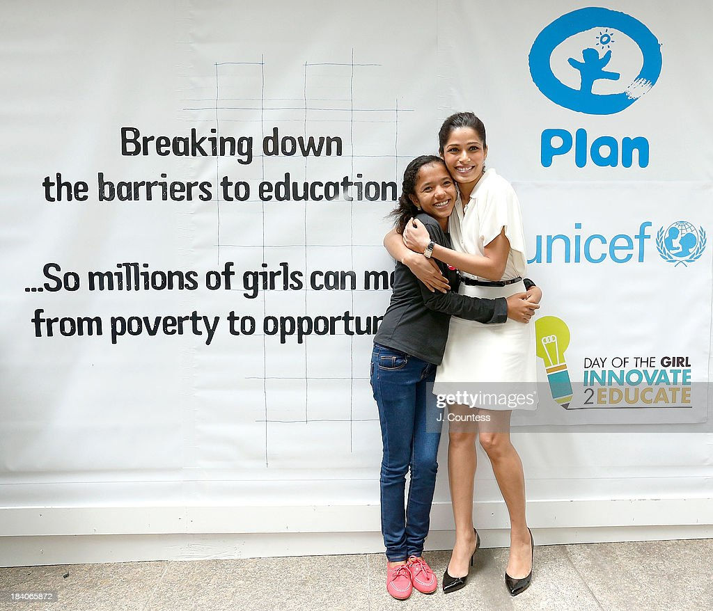 'Because I am a Girl' Youth Ambassador Tulsi Thapa and actress Freida Pinto pose for a photo during the 'Day Of The Girl' Fresco Unveiling With Freida Pinto at UNICEF House on October 11, 2013 in New York City.