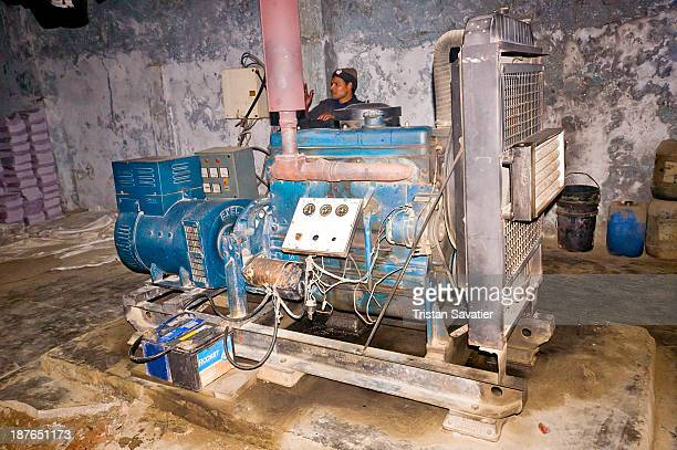 Because of frequent and unpredictable power outages, every factory in India must have their own power generator. This one is made from a diesel truck...