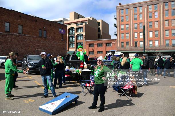 Because of the cancelation of Denver's St Patricks Day parade Kelly Mahoney of Denver front and about couple of dozens people are celebrating St...