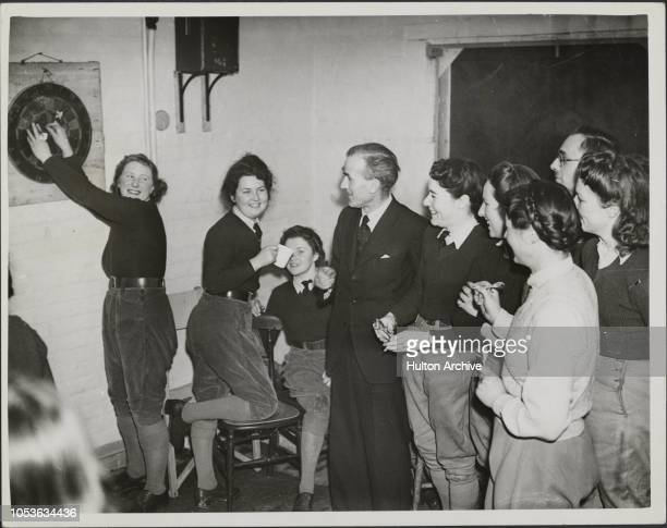 Because Of The Moon A New Year Party at the Women 's Land Army Toc M Club at Orpington was attended by Donald McCulloch The Club can only meet when...