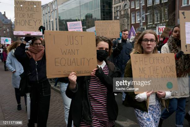 Because of the spread of the coronavirus some women attended the protest with masks during the International Women's Day rally on March 8 2020 in...